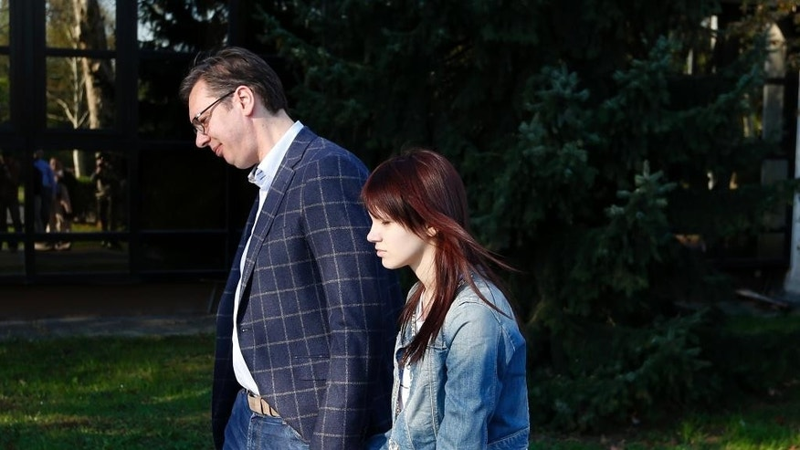 Current Serbian Prime Minister and presidential candidate Aleksandar Vucic, left, leaves a polling station with his daughter Milica after voting for the presidential elections in Belgrade, Serbia, Sunday, April 2, 2017. Around 6.7 million voters in Serbia choose a new president in an election Sunday that will test the popularity of the dominant, populist prime minister, Aleksandar Vucic, against 10 beleaguered candidates from the fragmented opposition. (AP Photo/Darko Vojinovic)