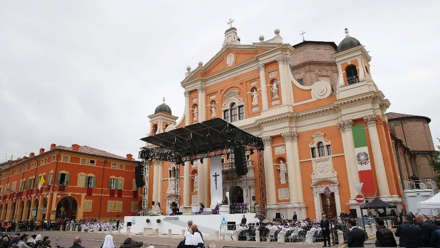 Pope Francis, seen on the stage, celebrates an open-air Mass in Carpi, northern Italy, for a one-day pastoral visit to Carpi and Mirandola, Sunday, April 2, 2017. Francis has arrived in the northern Emilia Romagna region hit by deadly quakes in 2012 on a visit meant to signal hope to central Italy, struck by a series of more devastating temblors last year. (AP Photo/Antonio Calanni)