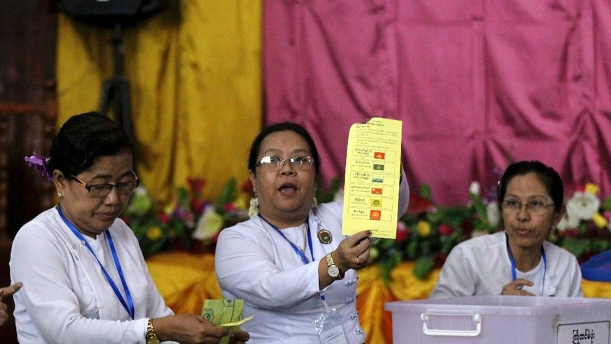An officials of Union Election Commission shows a spoilt vote as they count ballots at a polling station in Yangon, Myanmar, Saturday, April 1, 2017. Voters went to the polls Saturday for 19 by-elections in Myanmar, in the first test of the popularity of Aung San Suu Kyi's National League for Democracy since it formed the government a year ago. (AP Photo/Thein Zaw)