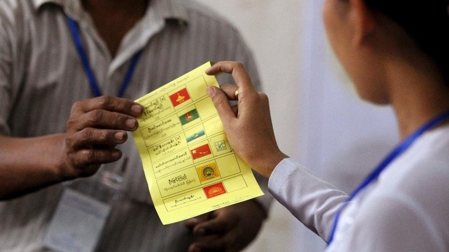 Officials of Union Election Commission count ballots at a polling station in Yangon, Myanmar, Saturday, April 1, 2017. Voters went to the polls Saturday for 19 by-elections in Myanmar, in the first test of the popularity of Aung San Suu Kyi's National League for Democracy since it formed the government a year ago. (AP Photo/Thein Zaw)
