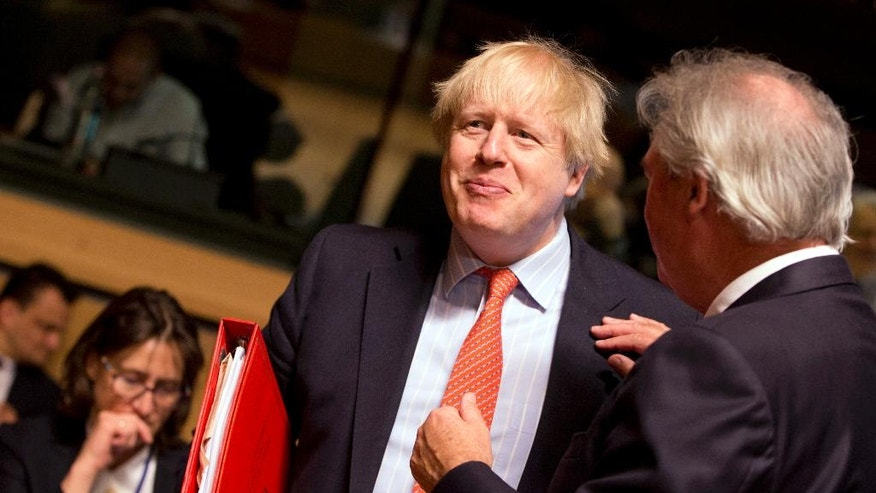 British Foreign Secretary Boris Johnson, left, speaks with Luxembourg's Foreign Minister Jean Asselborn during a meeting of EU foreign ministers at the EU Council building in Luxembourg on Monday, April, 2017. European Union foreign ministers meet Monday to discuss the situation in Syria and Libya. (AP Photo/Virginia Mayo)