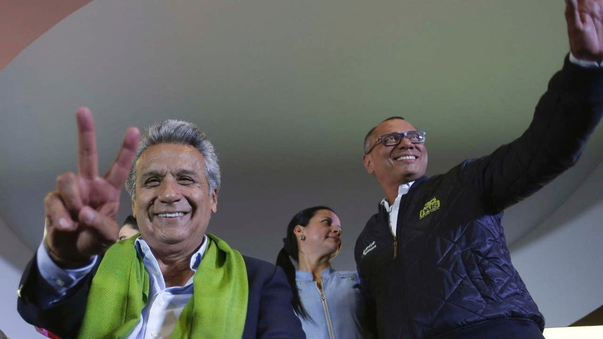 Alianza PAIS's presidential candidate Lenin Moreno, left, and his running mate Jorge Glas smile end of the day of the presidential election, in Quito, Ecuador, Sunday, April 2, 2017.