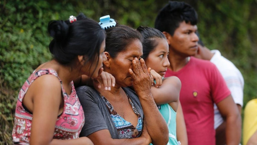 "People line up outside a cemetery to looking for their missing relatives in Mocoa, Colombia, Sunday, April 2, 2017. Colombia's President Juan Manuel Santos, who has declared Mocoa a disaster area, said that at least 207 were killed but that the death toll was changing ""every moment."" Authorities said another 200 people, many of them children, were injured and just as many were unaccounted for amid the destruction. (AP Photo/Fernando Vergara)"