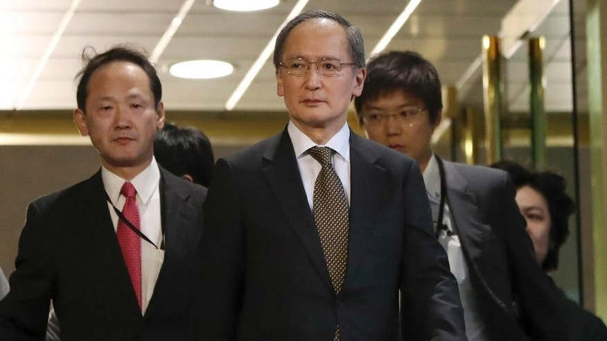 "FILE - In this Jan. 6, 2017 file photo, Japanese Ambassador to South Korea Yasumasa Nagamine, center, leaves the Foreign Ministry in Seoul, South Korea, after being summoned by South Korean Foreign Minister Yun Byung-se after Japan announced it would recall Nagamine and suspend economic talks in response to the placing of a ""comfort woman"" statue representing wartime sex slaves in front of its consulate in the Korean port city of Busan. Japan says it is sending back Nagamine despite an ongoing impasse over a ""comfort women"" statue. Japanese Foreign Minister Fumio Kishida said on Monday, April 3, Nagamine will fly back to Seoul on Tuesday along with the consul-general in Busan. (AP Photo/Lee Jin-man)"