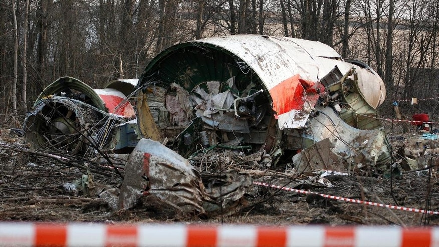 FILE - This Sunday April 11, 2010 file photo, shows the wreckage of the Polish presidential plane which crashed early Saturday in Smolensk, western Russia. Polish prosecutors allege Monday April 3, 2017, that a new analysis of evidence into the 2010 plane crash that killed Polish president Lech Kaczynski, shows that two Russian air traffic controllers and a third person in the control tower willingly contributed to the disaster, although they have withheld details of their evidence. (AP Photo/Sergey Ponomarev, FILE)