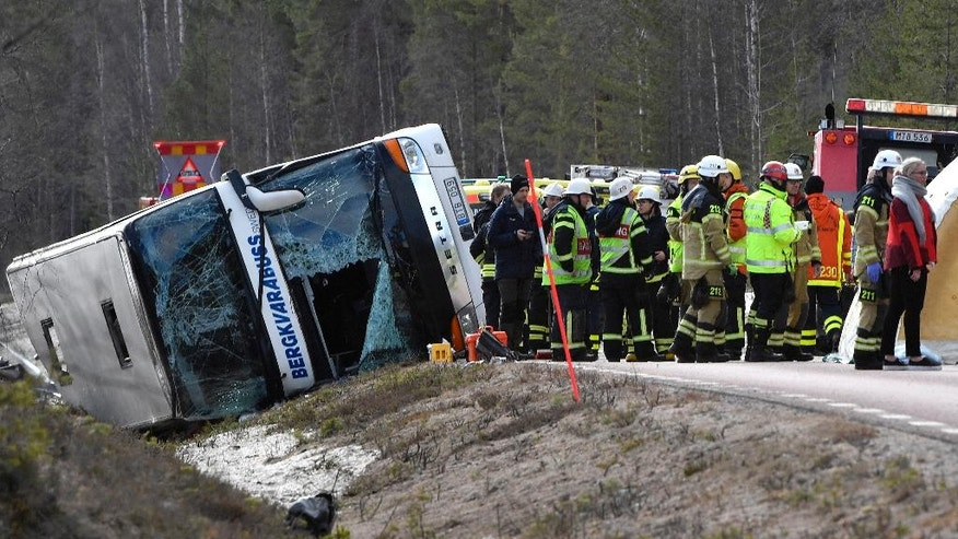 Emergency services and ambulance at the scene of a bus accident, on the E45 between Sveg and Fagelsjo in Sweden, Sunday, April 2, 2017. Three people were killed and over a dozen injured, six of them seriously when a bus carrying mostly schoolchildren crashed in central Sweden, rescue officials said Sunday. (Nisse Schmidt/ TT via AP)