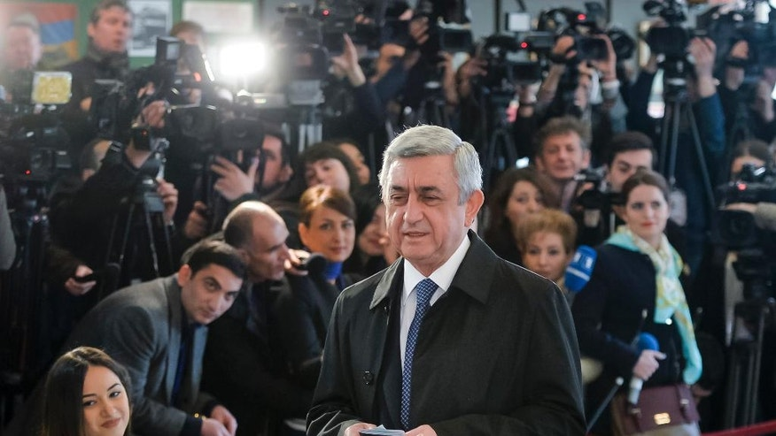Armenia's President Serzh Sargsyan arrives at a polling station during a parliamentary election in Yerevan, Armenia, Sunday, April 2, 2017. Armenians voted Sunday in the country's first parliamentary election since the ex-Soviet nation modified its constitution to expand the powers of parliament and the prime minister. (PAN Photo, Davit Hakobyan/Photo via AP)