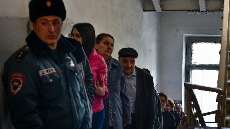 Armenians line up to vote at a polling station during a parliamentary election in Yerevan, Armenia, Sunday, April 2, 2017. Armenians voted Sunday in the country's first parliamentary election since the ex-Soviet nation modified its constitution to expand the powers of parliament and the prime minister. (PAN Photo, Karo Sahakyan/Photo via AP)