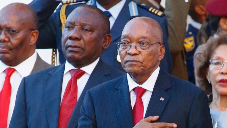 "FILE -- In this Thursday, Feb. 9, 2017 file photo, South African President Jacob Zuma, right, alongside deputy president Cyril Ramaphosa, left, outside parliament at the State of the Nation address in Cape Town, South Africa. Ramaphosa this weekend called for his countrymen to get rid of ""greedy"" and ""corrupt"" people, in remarks seen as an attack on Zuma. Ramaphosa was speaking after Zuma fired widely respected finance minister Pravin Gordhan in a cabinet reshuffle last week in which he purged other political opponents. (AP Photo/Nic Bothma, Pool, File)"