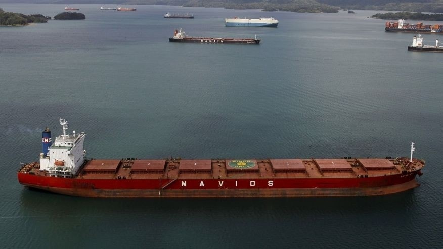 An aerial view of a cargo ship in the Panama Canal is seen during an organised media tour by Italy's Salini Impregilo, one of the main sub contractors of the Panama Canal Expansion project March 23, 2015.