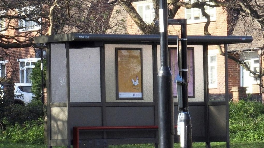 "A general view of the bus stop in Croydon, south London, Monday April 3, 2017, where a 17-year old Iranian-Kurdish asylum seeker was attacked by a group of people in a suspected hate attack on Friday March 31.  Police have detained some suspects in connection with what they described as a ""brutal attack"" on the asylum seeker who was fighting for his life in hospital but is ""starting to make a recovery"", police said Monday.(Georgina Stubbs/PA via AP)"