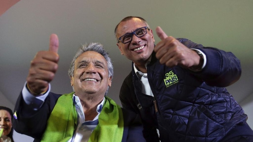 Alianza PAIS's presidential candidate Lenin Moreno, left, and his running mate Jorge Glas smile at the end of the day of the presidential election, in Quito, Ecuador, Sunday, April 2, 2017. Ecuador went to the polls in a second round presidential elections. (AP Photo/Dolores Ochoa)