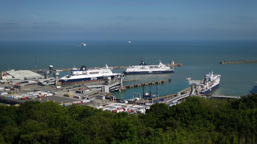 FILE - In this June 9, 2016 file photo ferries come and go from the Port of Dover, in Dover, south east England. On a clear day, the coast of France is visible from Dover's famous white cliffs. A period of slow erosion, then a cataclysmic split. Britain's geographic separation from the European mainland foreshadowed the present Brexit process in many ways, a new study shows. (AP Photo/Matt Dunham, file)