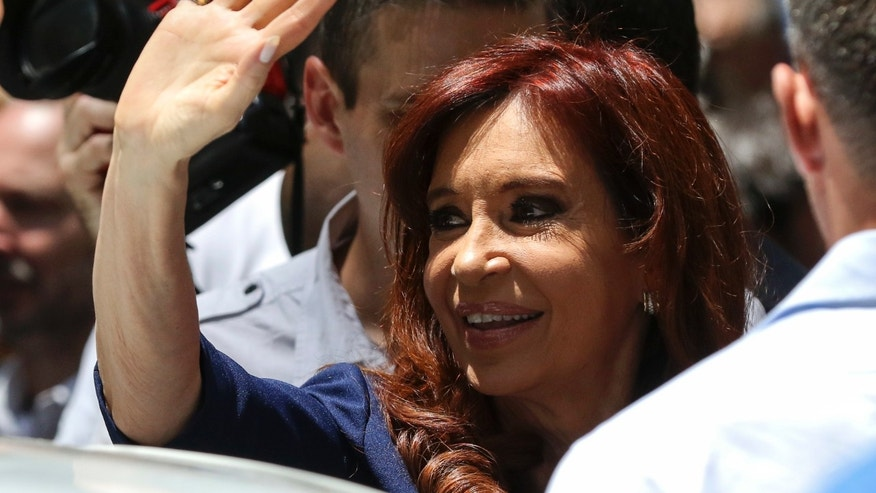 Argentina's former President Cristina Fernandez wavesto supporters as she leaves the Cuban Embassy in Buenos Aires, Argentina, Tuesday, Nov. 29, 2016.