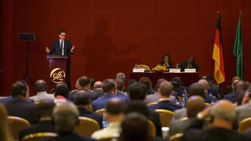 "Germany's Federal Minister for Economic Cooperation and Development Gerd Mueller makes an address at a hotel in Addis Ababa, Ethiopia Tuesday, April 4, 2017. While announcing Tuesday what he called a ""Marshall Plan with Africa"" focused on improving economic growth, security and rule of law, Mueller said the United States' plan to spend more on its military won't guarantee peace and criticised the Trump administration's proposed cuts to foreign aid. (AP Photo/Mulugeta Ayene)"