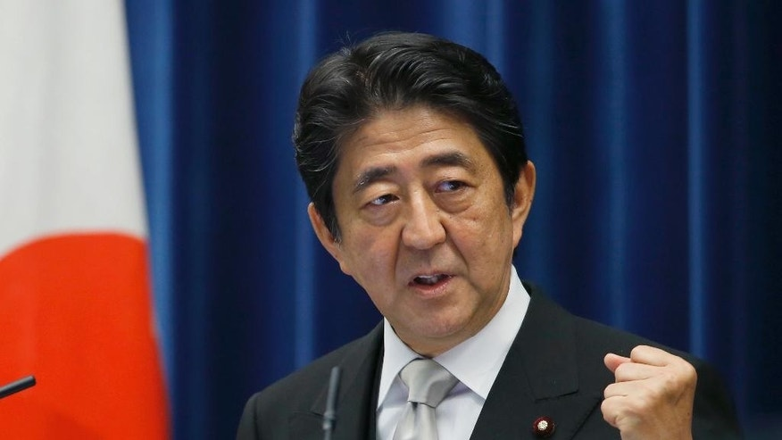 FILE - In this Aug. 3, 2016 file photo, Japan's Prime Minister Shinzo Abe speaks during a press conference after he reshuffled his Cabinet at the prime minister's official residence in Tokyo. Opposition politicians on Tuesday, April 4, criticized a decision by Japan's Cabinet to allow schools to study a 19th century imperial order on education that was banned after World War II for promoting militarism and emperor worship, saying it's a sign that Abe's government is becoming more nationalistic. The Cabinet adopted the policy Friday, March 31. (AP Photo/Shizuo Kambayashi, File)