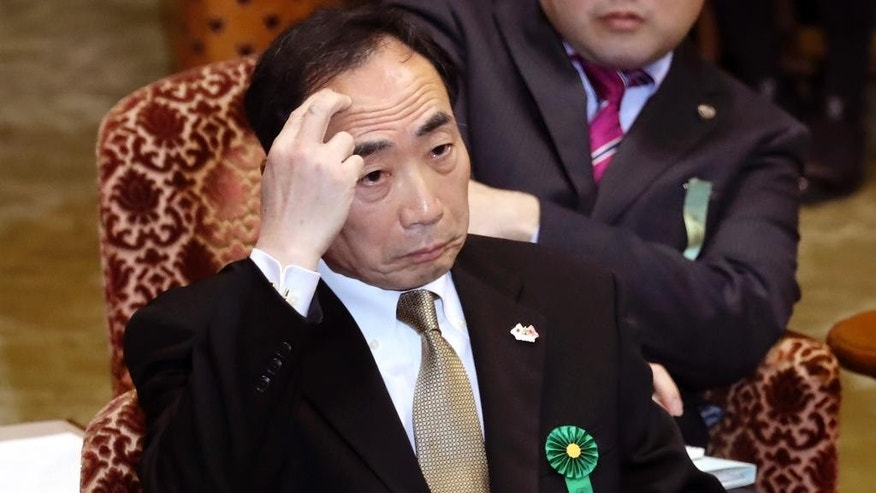 FILE - In this Thursday, March 23, 2017 file photo, Yasunori Kagoike, head of an ultra-nationalistic Japanese school operator, gestures as he testifies before an upper house panel at the parliament in Tokyo over a land and political scandal in which Kagoike said Prime Minister Shinzo Abe donated 1 million yen ($9,000) in 2015 through his wife Akie Abe for an elementary school where she once was honorary principal. Opposition politicians criticized Tuesday, April 4, a decision by Japan's Cabinet to allow schools to study a 19th century imperial order on education that was banned after World War II for promoting militarism and emperor worship, saying it's a sign that Abe's government is becoming more nationalistic. Kagoike is among many Japanese conservatives who have tried to reinstate the imperial message. (AP Photo/Eugene Hoshiko, File)