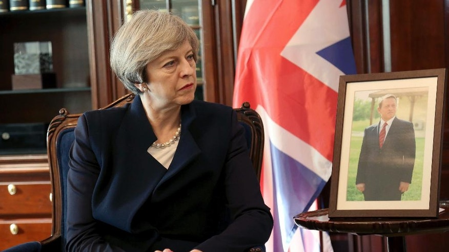 British Prime Minister Theresa May meets Jordanian Prime Minister Hani al-Mulqi in Amman, Jordan, Monday, April 3, 2017. British Prime Minister Theresa May has begun a visit to Jordan where she is to announce plans to send more British military trainers to help the kingdom's air force in the fight against Islamic State extremists. (AP Photo/ Raad Adayleh)