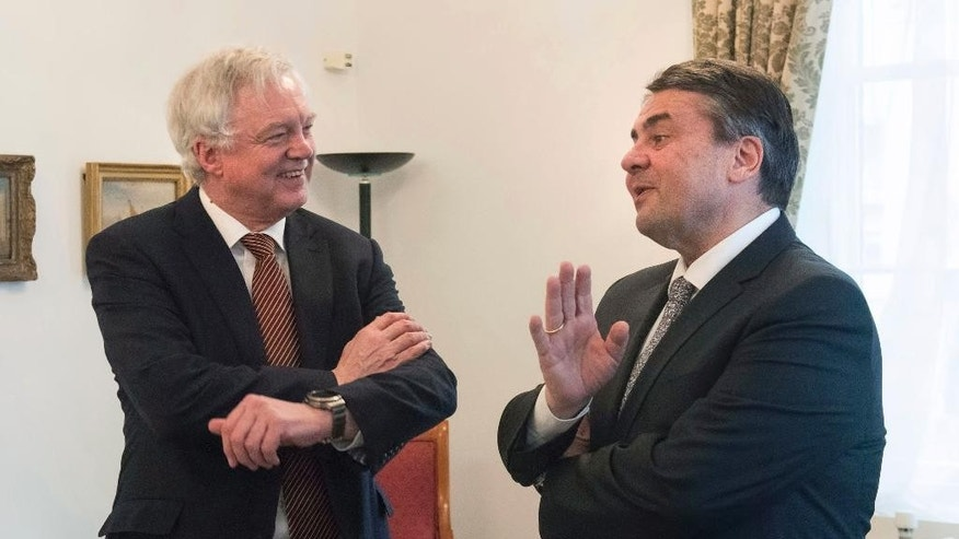 Britain's Secretary of State for the Department for Exiting the European Union, David Davis, left, meets with the German Foreign Minister Sigmar Gabriel at the Cabinet Office in London for talks Tuesday April 4, 2017.  Gabriel recently cast doubt on the two year timescale for Britain to negotiate its 'Brexit' exit from the European Union. ( Victoria Jones/Pool via AP)