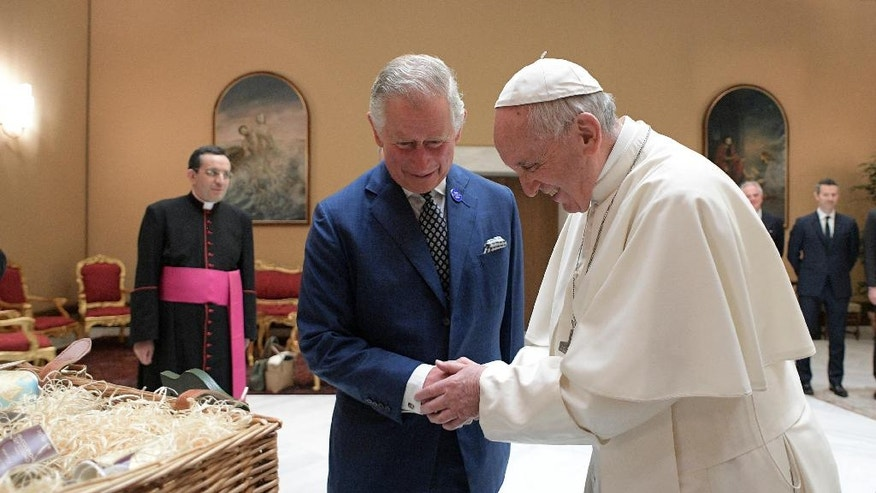 Pope Francis shakes hands with Britain's Prince Charles during a private audience at the Vatican, Tuesday, April 4, 2017. The heir to the British throne is on a three-country trip seen as an effort to reassure European Union nations that Britain remains a close ally despite its impending departure from the bloc. (L'Osservatore Romano/Pool Photo via AP)