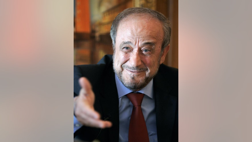 FILE - In this May 27, 2005 file photo, Rifaat Assad, the exiled uncle of Syrian President Bashar Assad speaks during an interview with The Associated Press in his office in Marbella, southern Spain. Spanish police are raiding properties and blocking bank accounts of relatives of Rifaat Assad, former Syrian vice president and uncle of the current Syrian president as part of a money laundering investigation after Spain's Civil Guard said searches on Tuesday April 4, 2017 were carried out in the southern coastal towns of Marbella and Puerto Banus with the aid of French police. (AP Photo/Paul White, File)