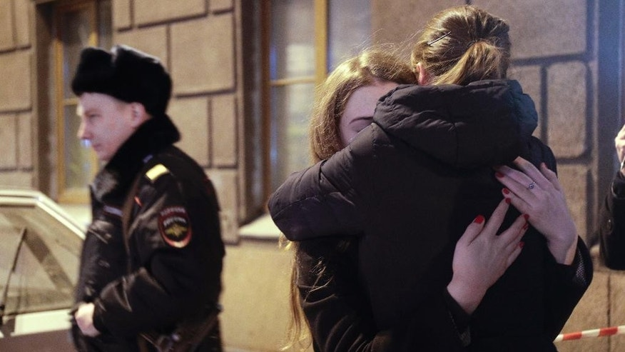 Women cry near the Tekhnologichesky Institut subway station in St.Petersburg, Russia, Monday, April 3, 2017. A bomb blast tore through a subway train deep under Russia's second-largest city Monday, killing several people and wounding many more in a chaotic scene that left victims sprawled on a smoky platform. (AP Photo/Dmitri Lovetsky)