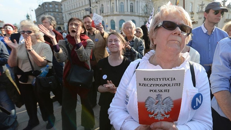 People demonstrate on the 20th anniversary of Poland's constitution in front of the presidential palace in Warsaw, Poland, on Sunday, April 2, 2017. The protest comes at a time that they and other poles fear the constitutional order in Poland is threatened by the country's populist government.(AP Photo/Czarek Sokolowski)