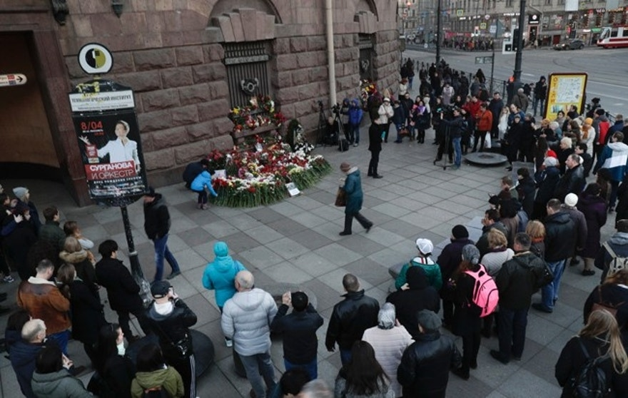 People gather at a symbolic memorial at Technologicheskiy Institute subway station in St. Petersburg, Russia, Tuesday, April 4, 2017. A bomb blast tore through a subway train deep under Russia's second-largest city St. Petersburg Monday, killing several people and wounding many more in a chaotic scene that left victims sprawled on a smoky platform. (AP Photo/Dmitri Lovetsky)