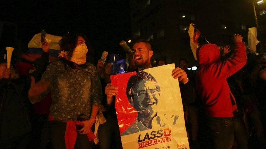 "Supporters of presidential candidate Guillermo Lasso protest near the Electoral National Council in Quito, Ecuador, Tuesday, April 4, 2017. Juan Pablo Pozo, president of the electoral council, announced the razor-thin election win by Moreno in a nationwide broadcast on radio and television. He said the results were ""official, irreversible"" with 99.65 percent of the votes counted. Lasso is demanding a recount. (AP Photo/Dolores Ochoa)"