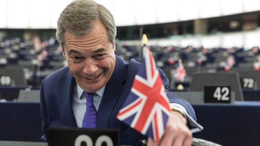 "Britain's former UKIP leader Nigel Farage attends a session at the European Parliament in Strasbourg, eastern France, Wednesday, April 5, 2017. The European Union's chief negotiator in the upcoming divorce proceedings with Britain says that parallel talks on its exit from the EU and a future trade relationship ""is a very risky approach"" he is bent on avoiding. (AP Photo/Jean-Francois Badias)"