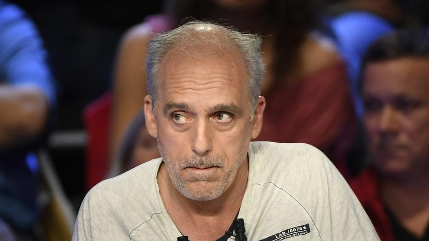 Presidential candidate for the far-left New Anticapitalist Party Philippe Poutou attends a television debate.