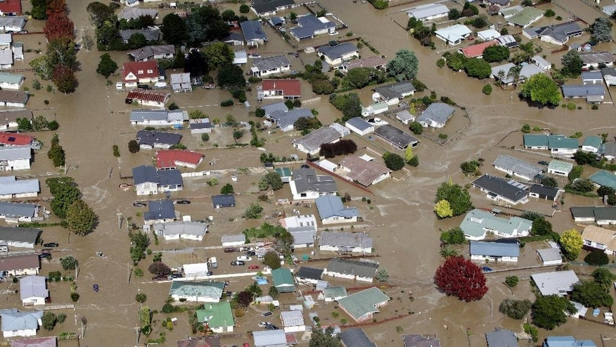 This photo shows the flooded streets of the North Island town of Edgecumbe in New Zealand, Thursday, April 6, 2017. People used jet boats and tractors to help rescue about 2,000 residents after a river burst through a concrete levee Thursday, flooding hundreds of homes and businesses. (Andrew Warner/The Bay of Plenty Times via AP)