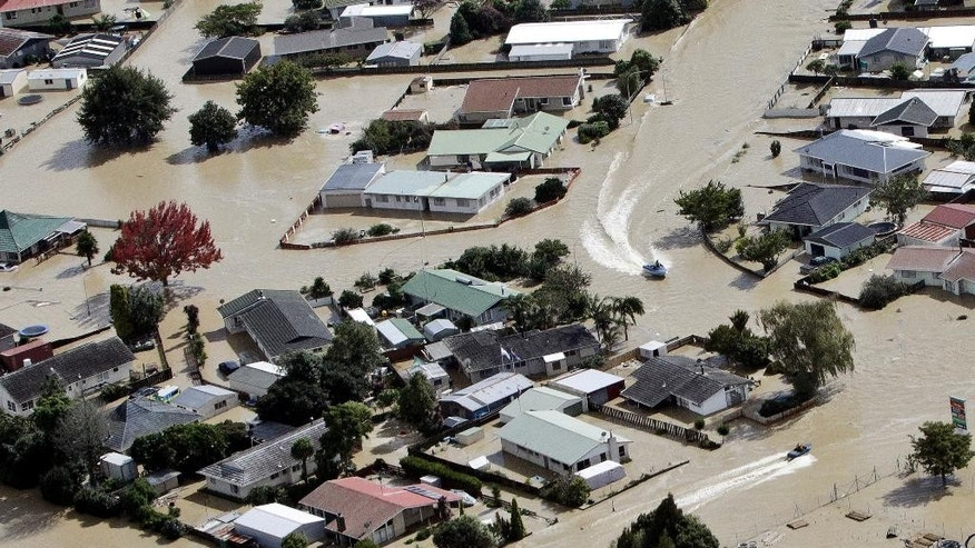 Jet boats drive through the flooded streets of the North Island town of Edgecumbe in New Zealand, Thursday, April 6, 2017. People used jet boats and tractors to help rescue about 2,000 residents after a river burst through a concrete levee Thursday, flooding hundreds of homes and businesses. (Andrew Warner/The Bay of Plenty Times via AP)