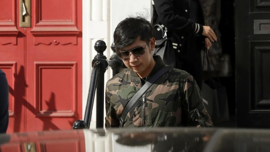 "Vorayuth ""Boss"" Yoovidhya, whose grandfather co-founded energy drink company Red Bull, walks to get in a car as he leaves a house in London, Wednesday, April 5, 2017.  Vorayuth earlier refused to answer questions about whether he will return to Thailand this month to meet with prosecutors over an alleged hit-and-run that killed a police officer almost five years ago. (AP Photo/Matt Dunham)"