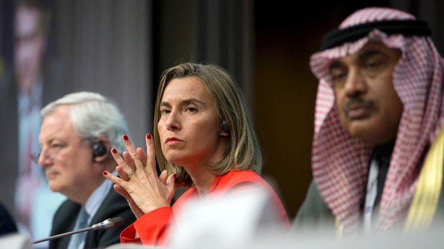 European Union High Representative Federica Mogherini, center, Kuwait's Foreign Minister Sheikh Sabah Khalid Al Hamad Al Sabah, right, and UN Office for the Coordination of Humanitarian Affairs Greg O'Brien listen to questions from journalists during a media conference at an EU Syria conference at the Europa building in Brussels on Wednesday, April 5, 2017. The EU and other nations met Wednesday to discuss what will be needed to rebuild war-ravaged Syria. (AP Photo/Virginia Mayo)