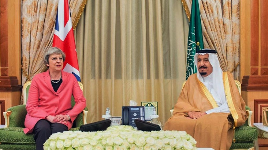 In this photo released by Saudi Press Agency, SPA, Saudi King Salman, right, receives British Prime Minister Theresa May, in Riyadh, Saudi Arabia, Wednesday, April 5, 2017. British Prime Minster Theresa May pitched the benefits of the London Stock Exchange on Wednesday during the second day of her two-day visit to Saudi Arabia as it weights which international market to list shares of oil giant Aramco in what many expect will be the largest public offering in history. (Saudi Press Agency via AP)