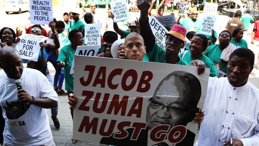"Demonstrators protest against South African President Jacob Zuma in Pretoria, South Africa, on Tuesday, April 4, 2017. Zuma responded to the political crisis that erupted after he fired the finance minister, acknowledging that public disputes at the top of the government are a ""serious weakness."" (AP Photo)"
