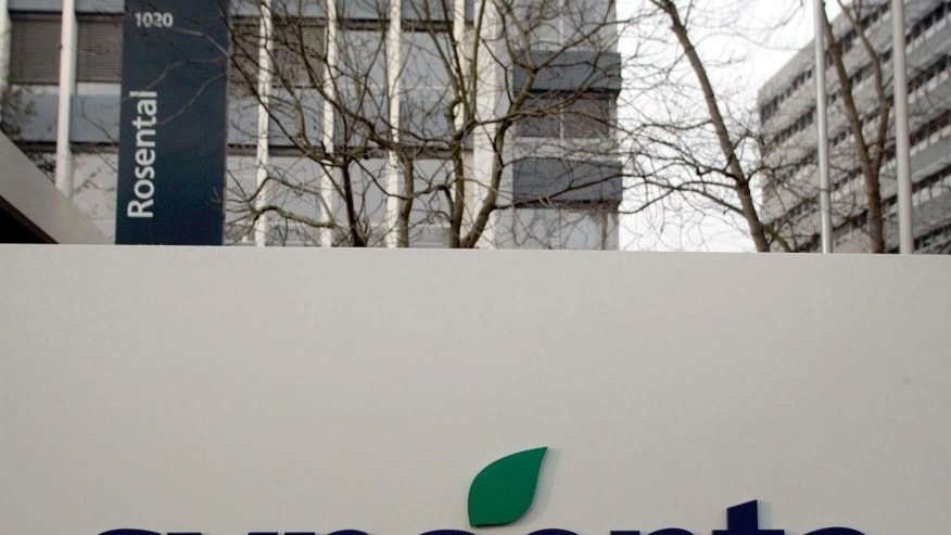 FILE -  This Feb. 7, 2007 file photo shows the logo and headquarters of the Swiss agribusiness giant Syngenta in Basel, Switzerland. U.S. regulators have agreed to a Chinese conglomerate's proposed $43 billion acquisition of Syngenta on condition it sells some businesses to satisfy anti-monopoly objections. The Federal Trade Commission's announcement on Tuesday, April 4, 2017, follows approval last year by European regulators of the purchase by state-owned ChemChina. It would be China's biggest foreign acquisition to date. (Georgios Kefalas/Keystone via AP, File)