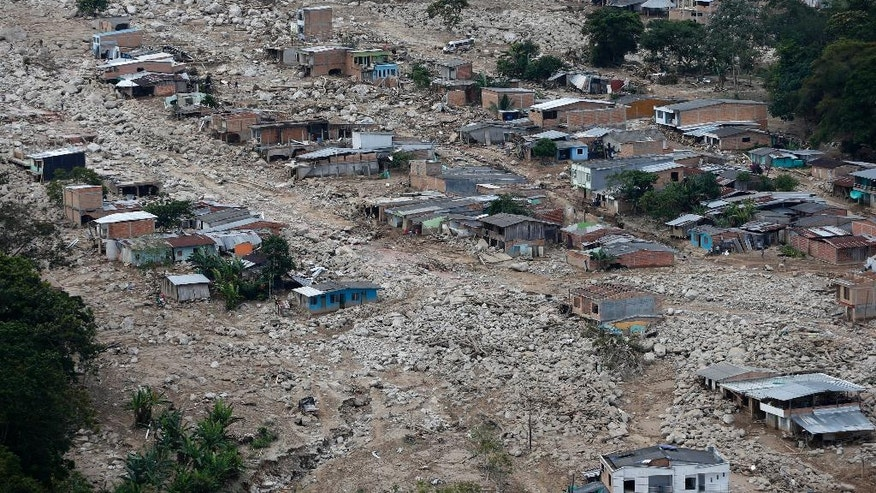 Boulders and debris surround homes damaged when rivers surrounding Mocoa overflowed and sent a wall of water and debris surging through the city over the weekend, in Mocoa, Colombia, Tuesday, April 4, 2017. Colombian authorities said at least 273 people were killed. The death toll was expected to rise since many more were missing and bodies are still being found. (AP Photo/Fernando Vergara)