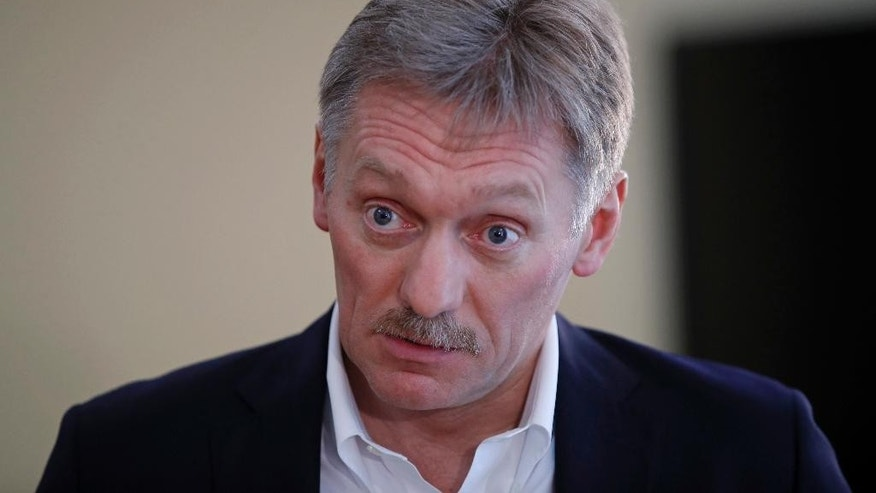 President Vladimir Putin's spokesman Dmitry Peskov speaks with The Associated Press in Moscow, Russia, Thursday, April 6, 2017.  Peskov tells The Associated Press that Russia's support for Syrian President Bashar Assad is not unconditional, with Putin's Spokesman talking several days after a suspected chemical weapons attack on a Syrian rebel-held province. (AP Photo/Pavel Golovkin)