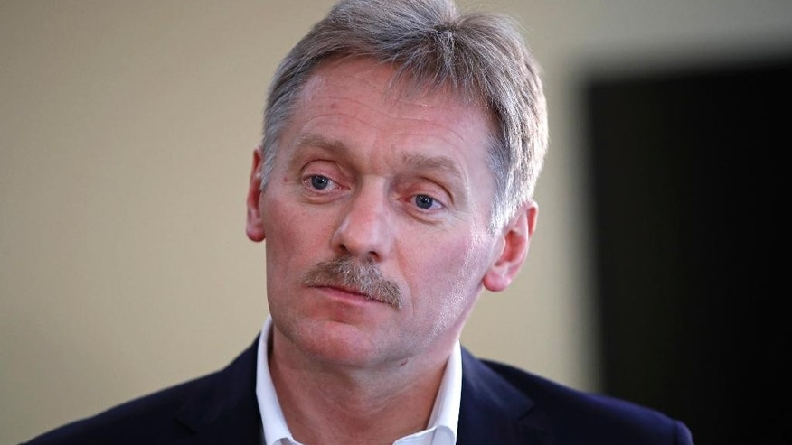 President Vladimir Putin's spokesman Dmitry Peskov speaks with The Associated Press in Moscow, Russia, Thursday, April 6, 2017.  Peskov tells The Associated Press that Russia's support for Syrian President Bashar Assad is not unconditional, with Putin's Spokesman talking just days after a suspected chemical weapons attack on a Syrian rebel-held province. (AP Photo/Pavel Golovkin)