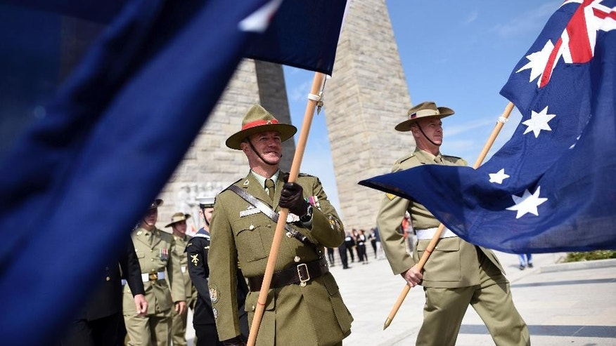 FILE - In this April 24, 2016, file photo, soldiers from Australia and New Zealand march during the Turkish International Service at Mehmetcik Abide on the Gallipoli Peninsula, Turkey. Australian Veterans Affairs Minister Dan Tehan on Thursday, April 6, 2017, urged the nearly 500 Australians and New Zealanders registered to travel to Gallipoli, Turkey, to mark ANZAC Day on April 25 to exercise a high degree of caution amid the warning, but offered no specifics about the alleged threat. (AP Photo/File)