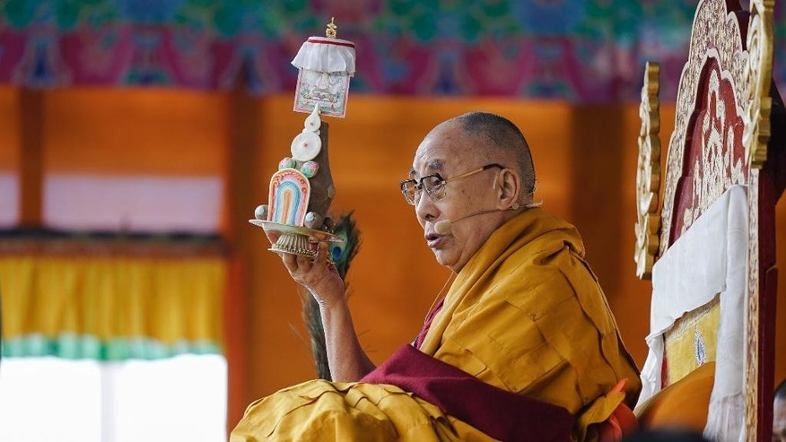 Tibetan spiritual leader the Dalai Lama performs a ritual before teachings at the Buddha Park in Bomdila, Arunachal Pradesh, India, Wednesday, April 5, 2017. China criticized India on Wednesday for allowing the Dalai Lama to visit the disputed border region, saying it did not consider the matter a purely internal Indian affair and warning it would damage bilateral relations. India said Tuesday that China should not interfere in its domestic issues, as the Dalai Lama began a weeklong visit to Arunachal Pradesh in India's remote northeast. ( AP Photo/ Tenzin Choejor)