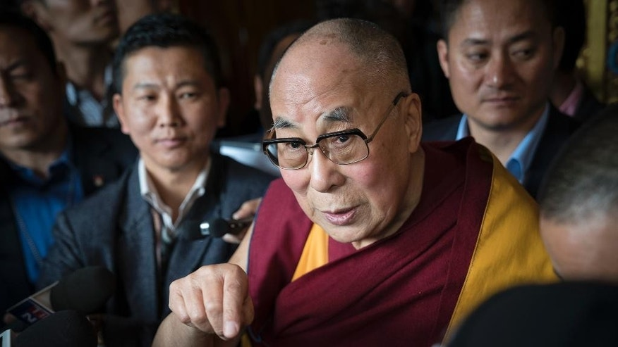 Tibetan spiritual leader the Dalai Lama, talks to the media after consecrating the Thupsung Dhargyeling Monastery in Dirang, Arunachal Pradesh, India, Thursday, April 6, 2017. The Dalai Lama consecrated the Buddhist monastery on Thursday in India's remote northeast, amid Chinese warnings that the exiled Tibetan spiritual leader's visit to the disputed border region would damage bilateral relations with India. (AP Photo/ Tenzin Choejor)