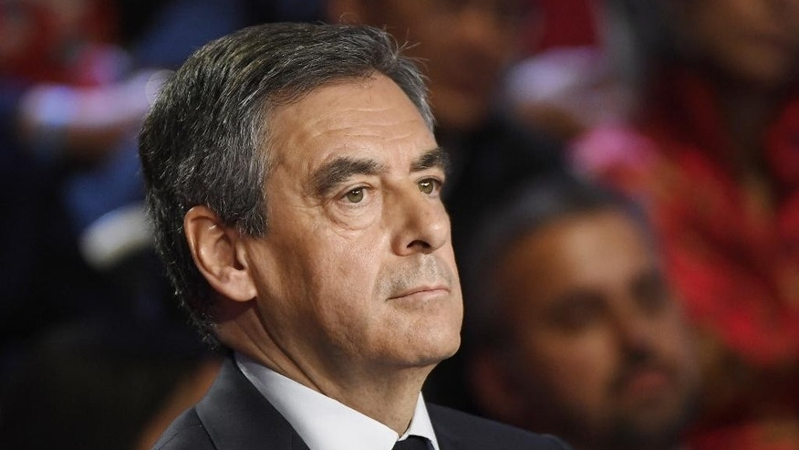 Conservative presidential candidate Francois Fillon attends a television debate at French private TV channels BFM TV and CNews, in La Plaine-Saint-Denis, outside Paris, France, Tuesday, April 4, 2017. The 11 candidates in France's presidential race are preparing to face off in a crucial debate Tuesday evening, less than three weeks before the first round of the election. (Lionel Bonaventure/Pool Photo via AP)