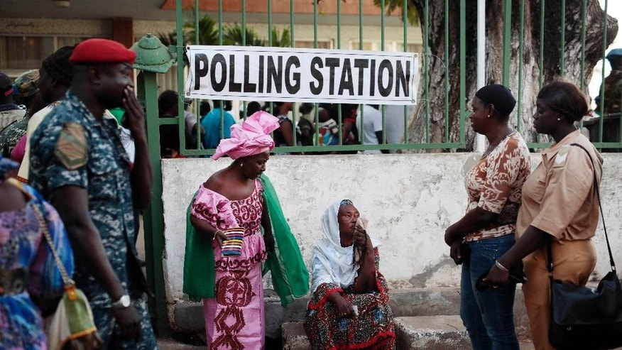 FILE- In this Thursday Dec. 1, 2016 file photo, Gambians wait to cast their vote at a polling station in Banjul, Gambia. Many Gambians hope to secure a transition from decades of dictatorship to democracy on Thursday, April 6, 2017, as they vote in parliamentary elections, the first since longtime leader Yahya Jammeh flew into exile in January. (AP Photo/Jerome Delay, File)