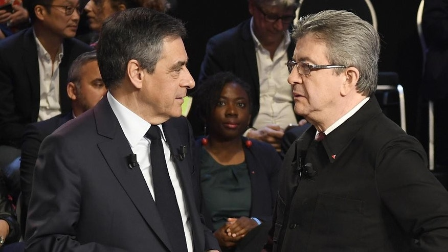 Conservative presidential candidate Francois Fillon, left, and Far-left presidential candidate for the presidential election Jean-Luc Melenchon talk together prior to a television debate at French private TV channels BFM TV and CNews, in La Plaine-Saint-Denis, outside Paris, France, Tuesday, April 4, 2017. The 11 candidates in France's presidential race are preparing to face off in a crucial debate Tuesday evening, less than three weeks before the first round of the election. (Lionel Bonaventure/Pool Photo via AP)