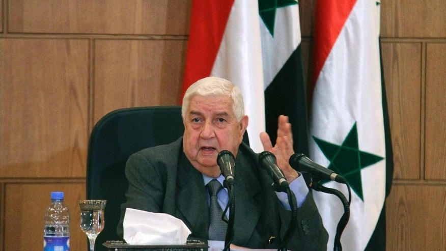 In this photo released by the Syrian official news agency SANA, Syrian Foreign Minister Walid Moallem, speaks during a press conference, in Damascus, Syria, Thursday, April 6, 2017. Moallem told reporters Thursday that it didn't use chemical weapons in Tuesday's deadly chemical weapons attack in Syria's northern Idlib province, and he blamed the rebels for stockpiling the deadly substance. Moallem said any investigative mission would need to take off from Damascus and be far from the sphere of Turkish influence. (SANA via AP)