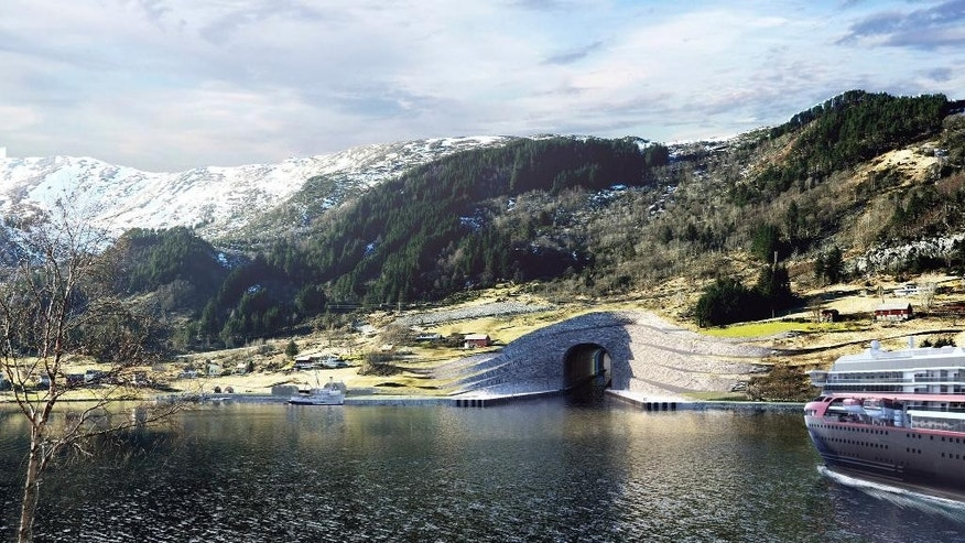 In this computer rendered image provided by the Norwegian Coastal Administration on Thursday, April 6, 2017, a ferry approaches the entrance of a tunnel for ships. Norway plans to build the world's first tunnel for ships, a 1,700-meter (5,610-feet) passageway burrowed through a piece of rocky peninsula that will allow vessels to avoid a treacherous part of sea. Construction of the Stad Ship Tunnel, which would be able to accommodate cruise and freight ships weighing up to 16,000 tons, is expected to open in 2023. (Snohetta/Norwegian Coastal Administration via AP)
