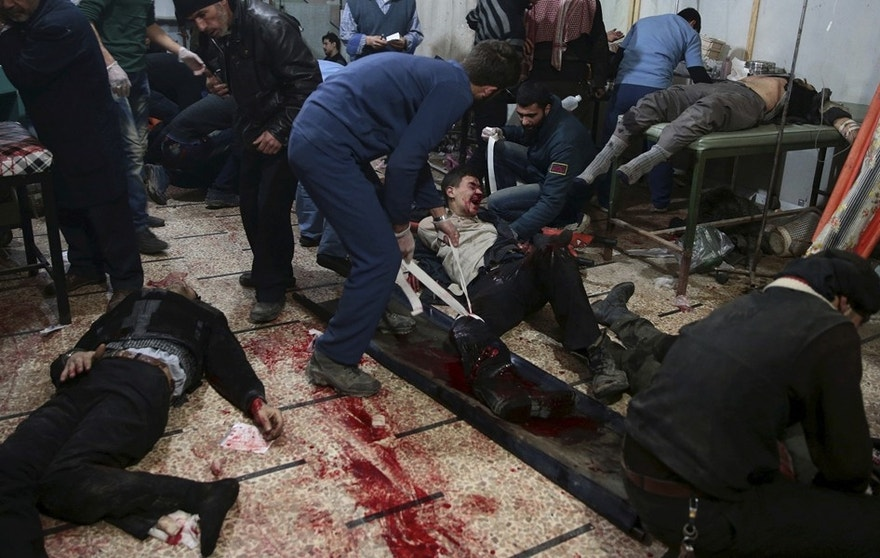 "ATTENTION EDITORS - VISUAL COVERAGE OF SCENES OF DEATH OR INJURY Medics treat injured people inside a field hospital after what activists said were air and missile strikes in the Douma neighborhood of Damascus, Syria December 13, 2015. Douma in Syria, an area controlled by rebels fighting to topple President Bashar al-Assad, has been shelled continuously for the past three years. The injured are taken to basements and shelters transformed into field hospitals run by medical staff who have stayed in the battered neighbourhood of Damascus. REUTERS/Bassam Khabieh   PICTURE 25 OF 37 - SEARCH ""KHABIEH HOSPITAL"" FOR ALL IMAGES TPX IMAGES OF THE DAYTEMPLATE OUT      TPX IMAGES OF THE DAY      - RTX1Z5H4"